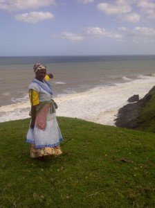 Ma Mtunasi (nee Belem) points out the location where the NS de Belem is believed to have sunk. The rusted metal rod that acts as a landmark is next to her feet.